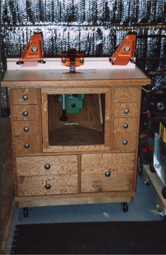 Gds woodworking nyw router table this shot of the top shows the t slots that the fence bolts through you can also see the laminate top surface and the router mounting plate keyboard keysfo Image collections